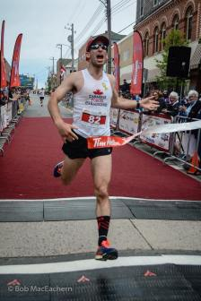 Crossing the finish line of Johnny Mile Marathon